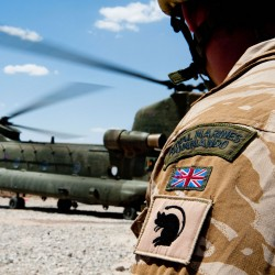 Royal Marines Commando, waiting for flight departure.