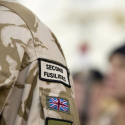 The Royal Regiment of Fusiliers. As part of the British Army standing in parade.